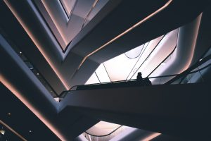 people on the stairs of a highly futuristic building